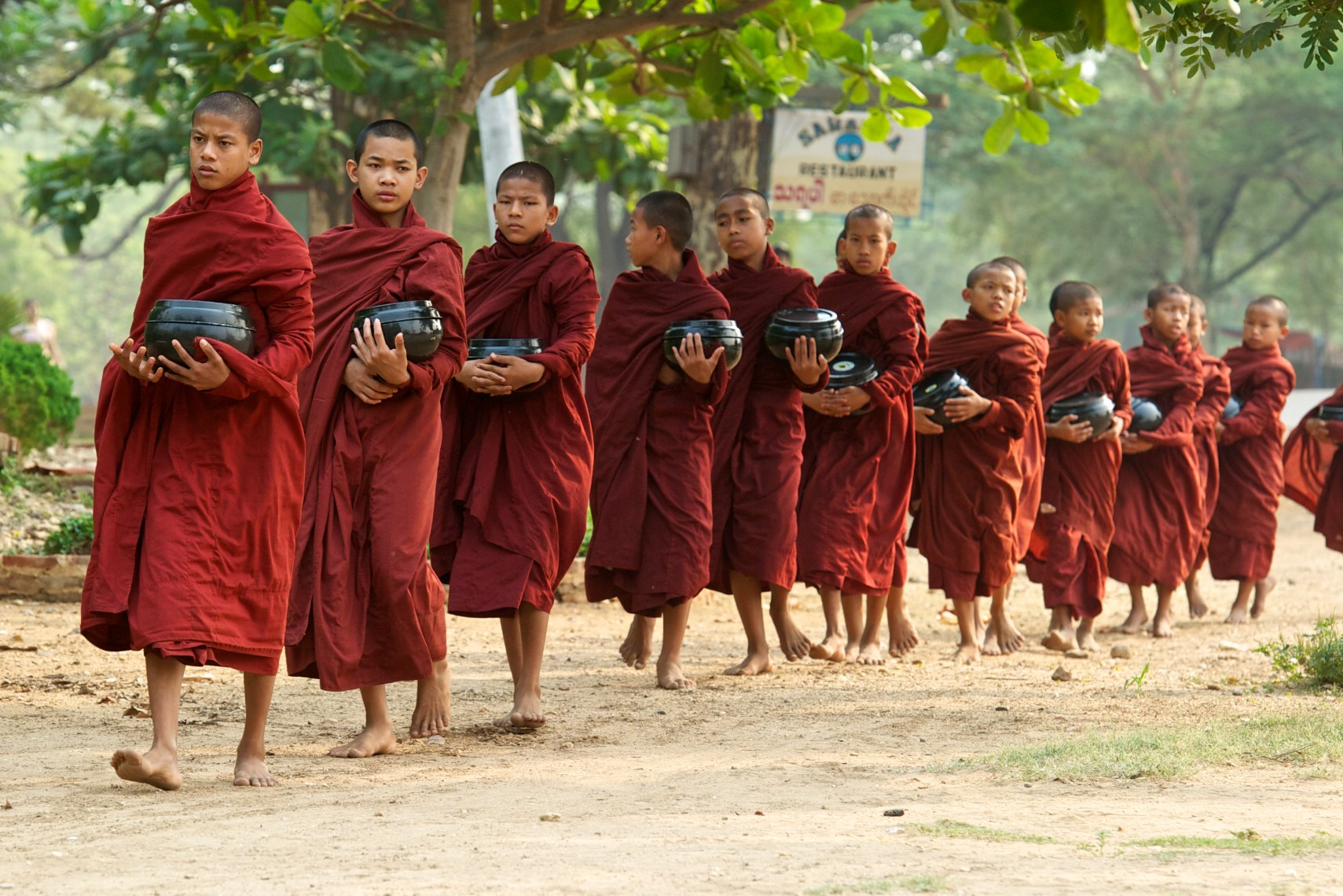 Burma Myanmar Bagan monks walking