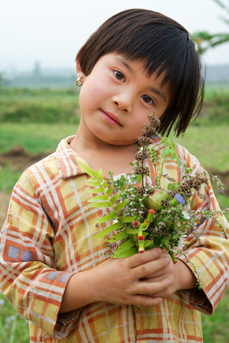 Burma Myanmar Hsipaw  young country girl with flowers
