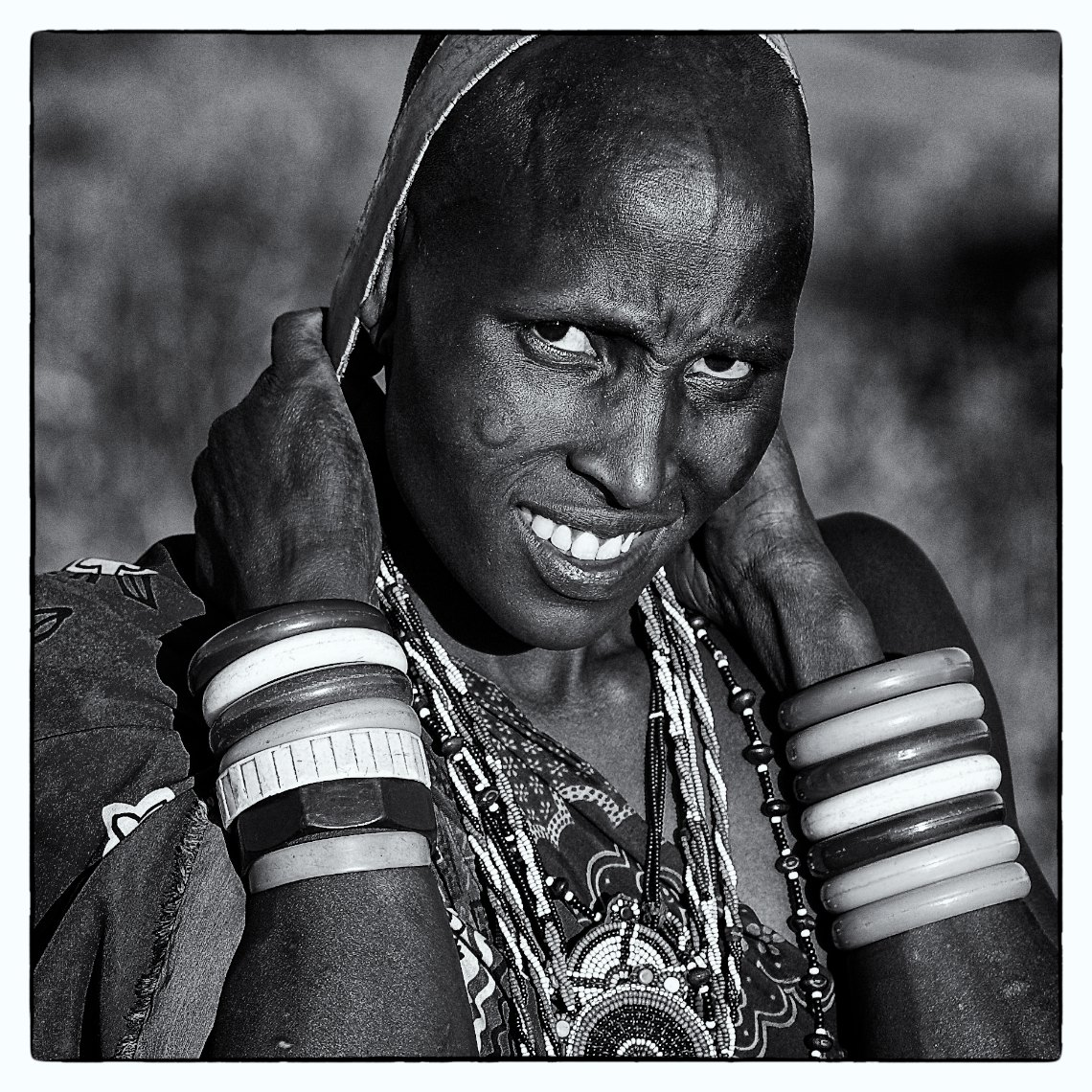 Kenya Amboseli Massai portrait woman carrying water