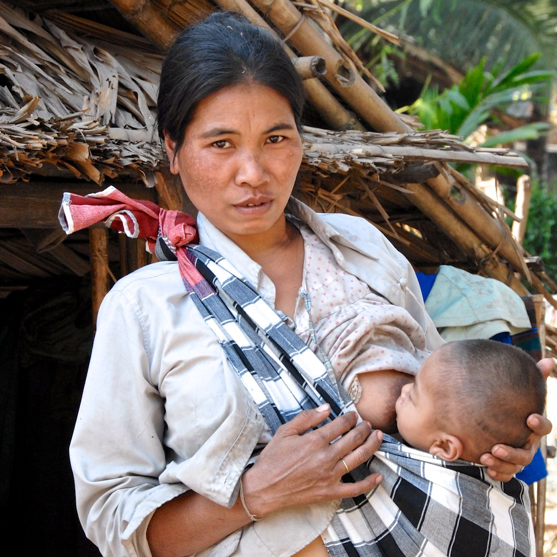 Laos portrait mother nursing child