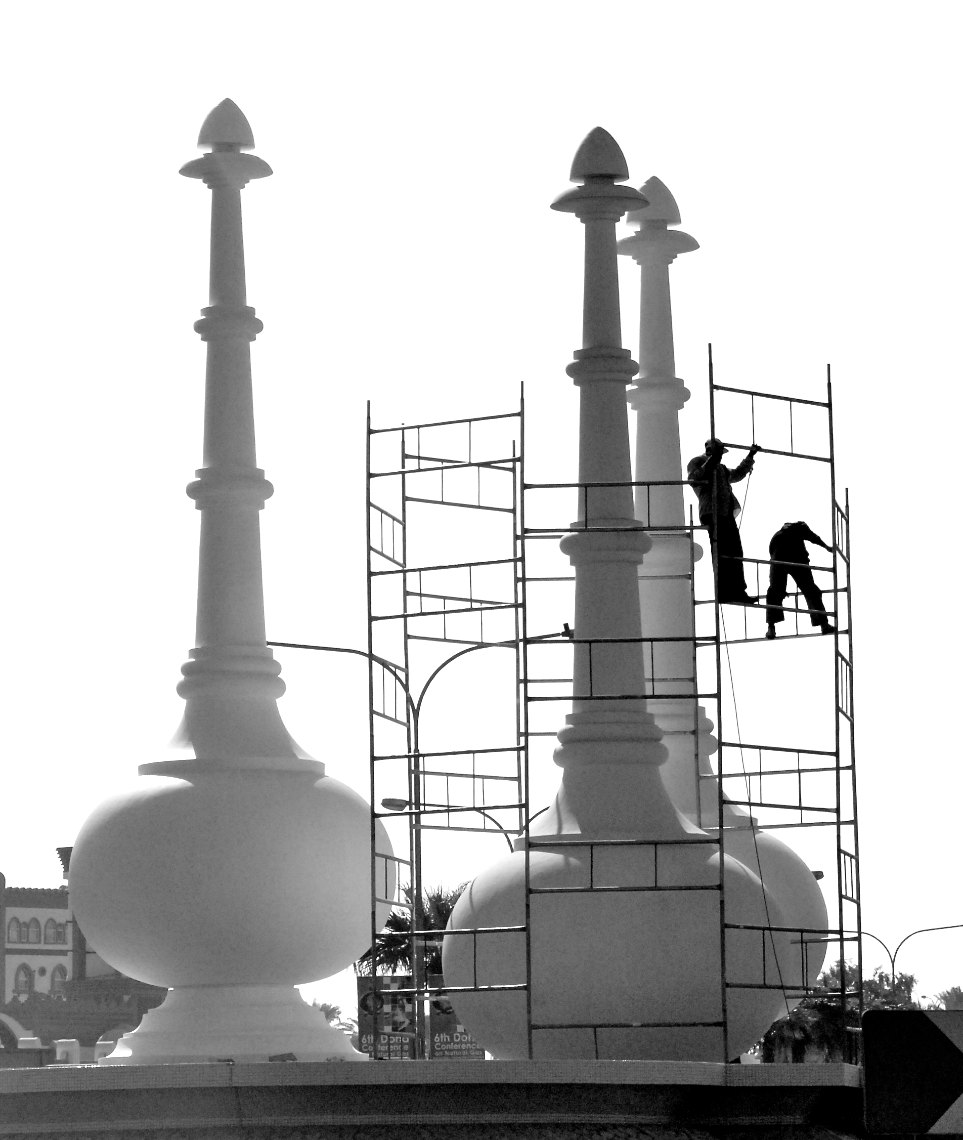 Qatar workers renovating monument